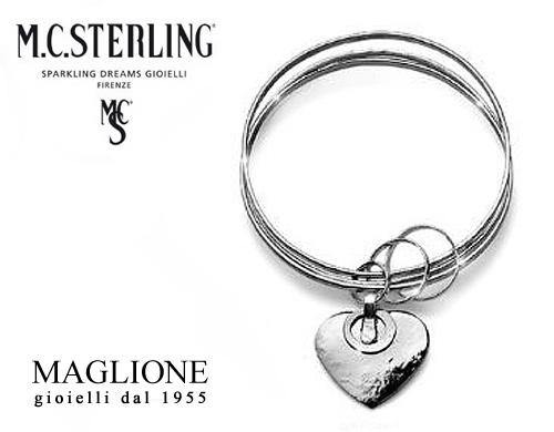 originale più votato classcic sconto in vendita Bracciale rigido Ikes a 3 cerchi con cuore pendente in argento 925 firmato  Maria Cristina Sterling