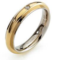 Fede Nuziale Unoaerre modello Andromeda in oro bianco ed oro giallo 18kt con diamante