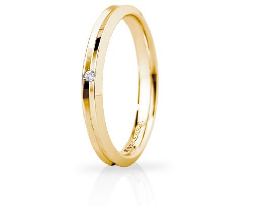 Fede Nuziale Unoaerre modello Corona Slim in oro giallo 18kt con diamante