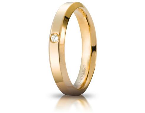 Fede Nuziale Unoaerre modello Hydra in oro giallo 18kt con diamante